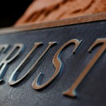 "Plaque that reads ""trust"""