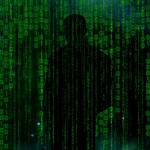 hacker-standing in shadows of data